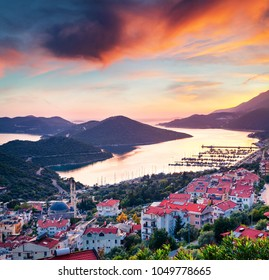 Dramatic spring view from the bird's eye of Kas city, district of Antalya Province of Turkey, Asia. Colorful spring sunset in small Mediterranean yachting and tourist town.