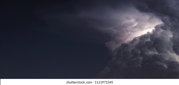 Dramatic Storm Clouds background. Lightning in the clouds. Night Clouds.