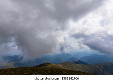 Dramatic storm clouds at sunset, in the Alps in summer