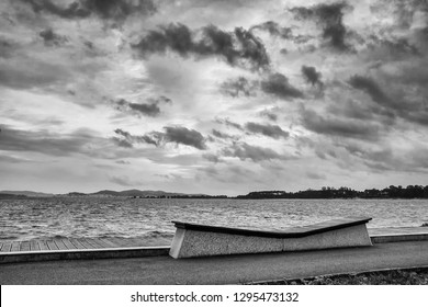Dramatic storm over Bao beach boardwalk in Arousa Island at back and white