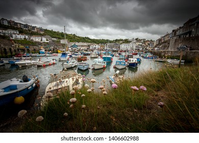 Dramatic stormy harbour scene in the quaint traditional Cornish fishing village of Mevagissey, Cornwall, England, UK