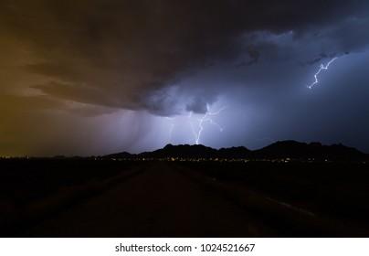 Dramatic stormy sky with cloud to ground lightning strike. Dangerous looking stormy cloud with lightning. Arizona monsoon season.