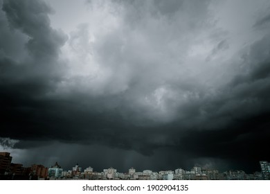 Dramatic stormy sky over modern city residential district. Low angle shot.