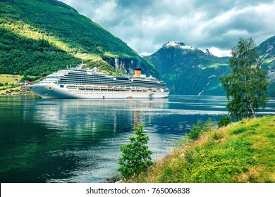 Dramatic summer scene of Geiranger port, western Norway. Colorful view of Sunnylvsfjorden fjord. Traveling concept background.