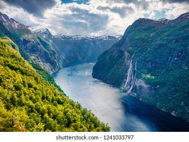 Dramatic summer scene of Sunnylvsfjorden fjord, Geiranger village location, western Norway. Beautiful morning view of famous Seven Sisters waterfalls. Beauty of nature concept background.