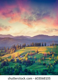 Dramatic summer sunrise in Carpathian village Kvasy. Colorful morning scene in the countryside. Beauty of nature concept background. Artistic style post processed photo.