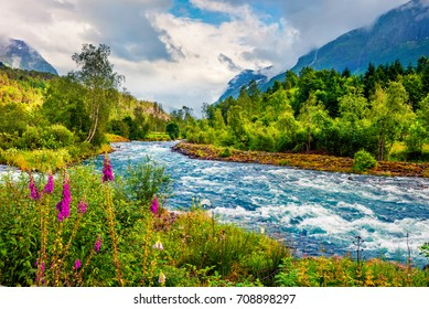 Dramatic summer view of Loelva river, located near Loen village, municipality of Stryn, Sogn og Fjordane county, Norway. Colorful sunny scene in Norway. Beauty of nature concept background.