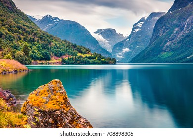 Dramatic summer view of Lovatnet lake, municipality of Stryn, Sogn og Fjordane county, Norway. Colorful morning scene in Norway. Beauty of nature concept background.