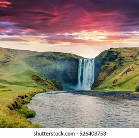 Dramatic summer view of Skogafoss Waterfall on Skoga river. Colorful summer sunrise in Iceland, Europe. Artistic style post processed photo.