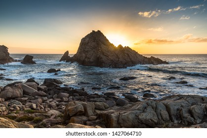 dramatic sunburst sugarloaf rock coastal beach west Australia Margaret river rocky rugged sunset India ocean