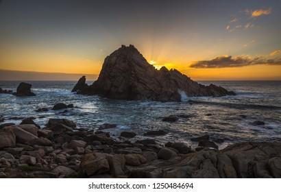 dramatic sunburst sugarloaf rocky rugged coastal sugarloaf rock west Australia Margaret river India ocean waves