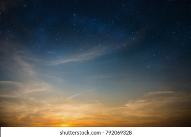Dramatic sun-lit sky filled with stars as beautiful natural background