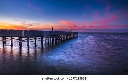 dramatic sunrise Brighton baths beach jetty pier early morning horizon coastal Melbourne bay reflections