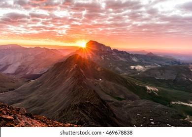 Dramatic Sunrise in the Colorado Rocky Mountains.  Photo taken from the summit of Wetterhorn Peak in the San Juan Range
