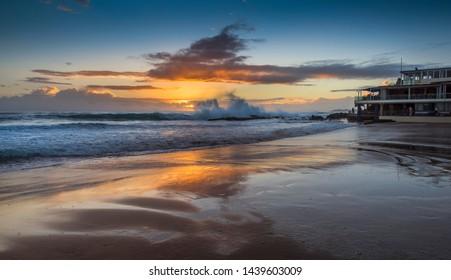dramatic sunrise Currumbin beach  ocean waves crashing gold coast coastal reflections