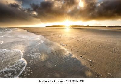 dramatic sunrise on North sea coast, Netherlands