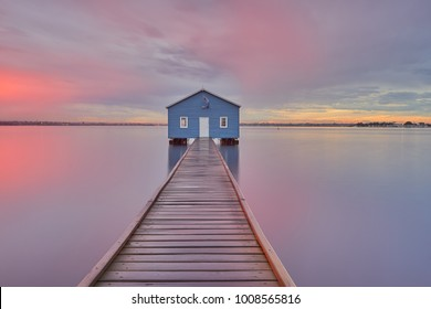 Dramatic sunrise over boathouse in the Swan River Perth, Australia