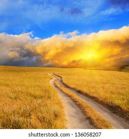 Dramatic sunrise over the meadow. Summer landscape.