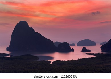 Dramatic sunrise over the mountains and the sea  in Thailand.