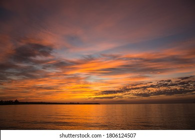 Dramatic sunrise over the river. Orange sunrise