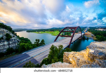 Dramatic Sunrise at Pennybacker Bridge or 360 Bridge an Austin Texas Landmark as the sun starts to shine on the limestone cliffs amazing vast Texas Hill Country Landscape