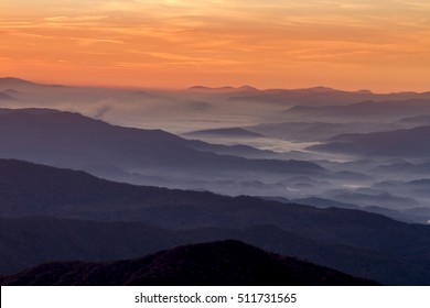 Dramatic sunrise sky with hazy mountain layers and fog at Clingmans Dome in Great Smoky Mountains National Park