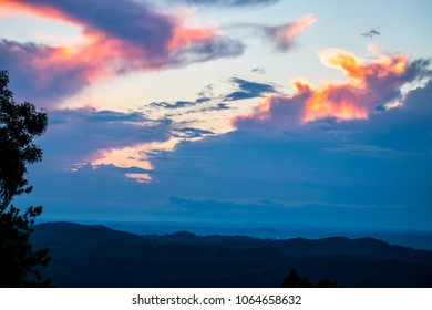 A dramatic sunrise in the Smoky Mountains paints the clouds pastel colors