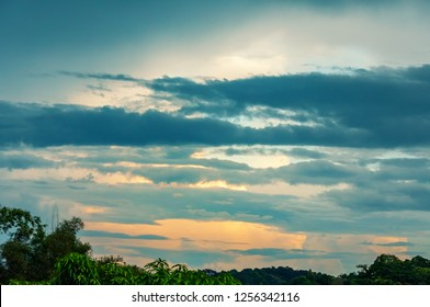 Dramatic of sunrise view with cloud sky and trees