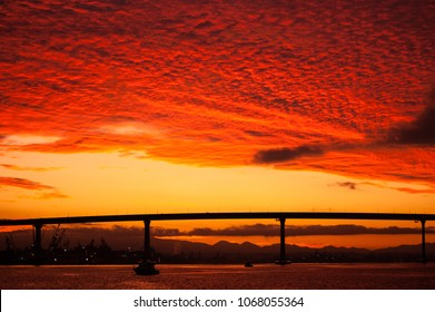 Dramatic sunrise view of the Coronado Island Bridge from the San Diego Harbor