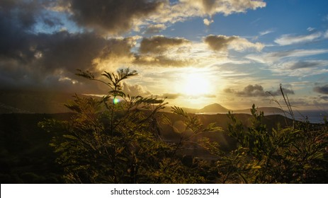 Dramatic sunrise and weather change view from Diamond head state park on Oahu, Hawaii.