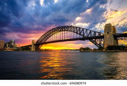Dramatic sunset above Harbour Bridge in Sydney, NSW, Australia.
