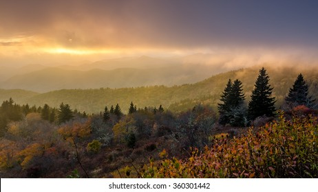 Dramatic sunset in breaking fog over the Blue Ridge Mountains