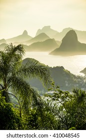 Dramatic sunset city skyline scenic overlook of Rio de Janeiro, Brazil with backlit silhouettes of Sugarloaf Mountain, Niteroi, and Guanabara Bay
