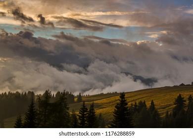 Dramatic sunset clouds and colores in the Dolomite Mountains, Italy, in summer