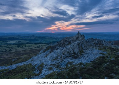 Dramatic sunset clouds over Manstone Rock the second-highest hill in county of Shropshire in Stiperstones, UK