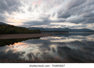 Dramatic Sunset Cloudscape Reflected on the Ashokan Reservoir in Upstate New York.