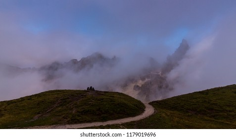 Dramatic sunset colors and rain clouds in the Pala Group, Dolomite Mountains, Italy