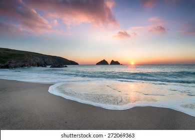 Dramatic sunset at Holywell Bay, a large sandy beach near Newquay in Cornwall