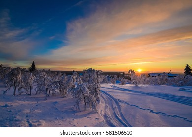 Dramatic sunset in Lapland. Northern Finland in February. Ivalo. Saariselka