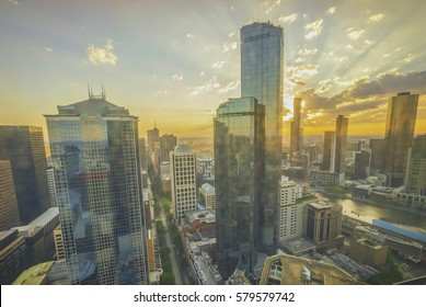 Dramatic sunset at Melbourne city skyline, aerial view
