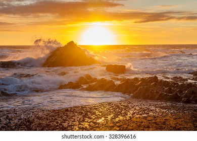 Dramatic sunset on the beach at Sandymouth near Bude North Cornwall England UK Europe