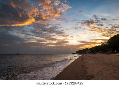 Dramatic sunset on Laiya beach in the municipality of San Juan, Batangas Province, at a short drive from Manila, Luzon island, Philippines.