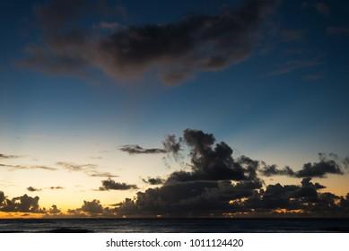 dramatic sunset on the Turtle Bay beach in Ohau, Hawaii