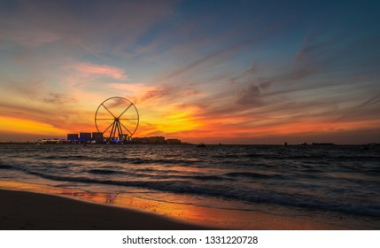 Dramatic sunset over the Bluewaters Island, Dubai, UAE. Сopy space