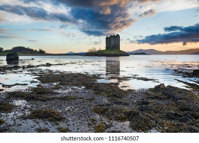 Dramatic sunset over Castle Stalker on an isle in Loch Linnhe in the Highlands of Scotland