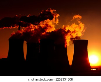 dramatic sunset over coal power plant