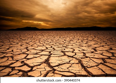 dramatic sunset over cracked earth. Desert landscape background. Global warming concept