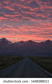 Dramatic sunset over empty road in Iceland
