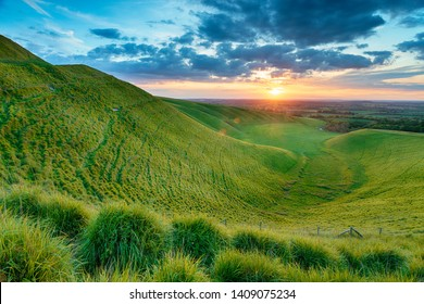 Dramatic sunset over The Manger on White Horse Hill at Uffington in Oxforshire, it is on the Ridgeway long distance walking route and forms part of the Berkshire Downs