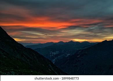 Dramatic sunset over mountain landscape of Vanoise National Park, Alps, Auvergne-Rhône-Alpes, France